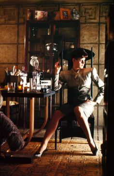 Sean Young's Nexus-noir-vamp, looking ridiculously hot and pouty on the moody lit set of Blade Runner.