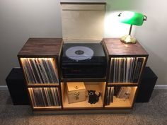 Indepth look at 10 of the most stylish and affordable record player stands, consoles and cabinets. Inovative wood work and unique designs. Record Player Furniture, Record Table, Record Player Console, Record Stand, Vinyl Record Player, Lp Player, Record Players, Vinyl Record Cabinet, Vinyl Record Storage