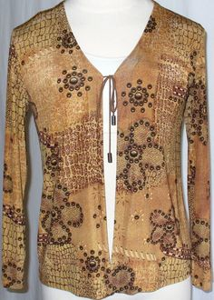 #Chico's Travelers Animal Print Tie-Front Jacket. Printed in golden yellow and brown snakeskin and closes with a brown suede leather tie.