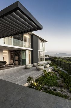 Modern Melkbos Home - Visi Modern Family, Home And Family, Modern Light Fittings, Slide Screen, Timber Staircase, Timber Screens, Indoor Outdoor, Entrance, Beach House