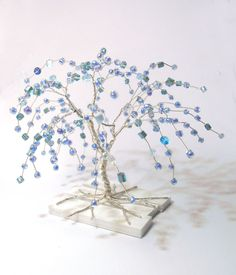 wire tree, silver plated copper wire and turquoise-blue beads. $17.00, via Etsy.