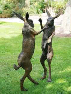 Iron resin #sculpture by #sculptor Martin Duffy titled: 'Boxing Hares (Mad March Hares life size Boxing statue)'. #MartinDuffy