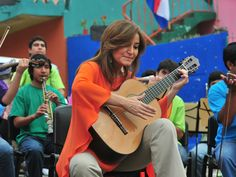 "Classical guitarist brings real instruments to Paraguay's ""landfill"" children's orchestra, changes lives"