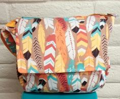 """Native Feathers Boy Diaper Bag.  2 exterior side bottle pockets Spacious Interior  14"""" x 11.5"""" x 5"""" Strap Drop 14"""" - 28"""" USA made by Elonka Nichole"""