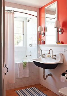 love how the tub is framed in with tile + curved shower curtain, although I would prefer a longer shower curtain