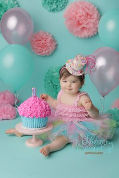 Pink and turquoise cake smash with pink and blue giant cupcake.