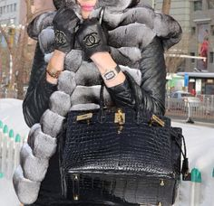 """A fine example of a """"label"""" queen. This black, alligator Birkin with gold fixtures, speaks for itself."""