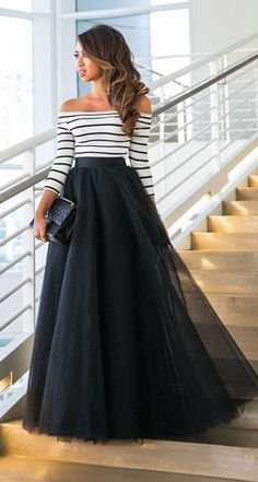 Black tulle skirt with a casual touch on her blouse sailor type.