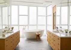 natural wood vanities, big windows