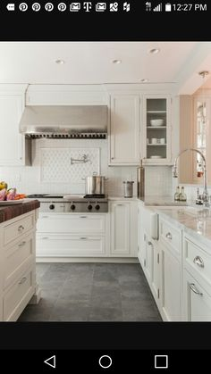 Elegant Kitchen Photo In Boston With A Farmhouse Sink Recessed Panel  Cabinets White Cabinets White Backsplash Stainless Steel Appliances And  Slate Floors ...