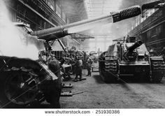 Soviets (Russians) assembling tanks at a Soviet plant in the Urals. The factory maintained day and night schedules during World War 2. - stock photo