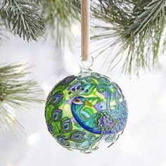Proudly add this beautiful peacock to your tree this year. Our ornament has been meticulously handcrafted using the traditional technique of copper and enamel cloisonne. It& sure to be a holiday favorite for years to come. Exclusively at Pier