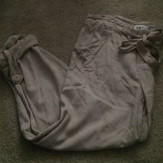 Khaki colored, loose fit, cuffed capris Hit about mid calf, cuff accent, loose fitting but not baggy, cute tie front features, banded waist, never worn, purchased at Von Maur, original price unknown Jolt Pants Capris