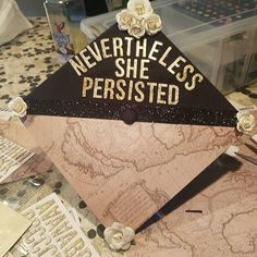 My grad cap that I decorated this past weekend! I really love that I found paper at Joanns that is a map of California as an island, which is my favorite historical map. Everyone will know that I am a feminist and a geographer on first sight! =P
