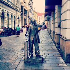 """Ignác Lamár a.k.a Schöner Náci was a renowned #Bratislava character of the mid-20th century. The legend has it he was left abandoned at the altar by his fiancé, resulting in Ignác losing his sanity. Since that sad day, he was walking the streets of Bratislava elegantly dressed in top hat and tails, with a nicely wrapped gift and greeting women with the words """"I kiss your hand"""" in Hungarian, Slovak and German (statue by Juraj Meliš, photo by bluecaravel, facts from Wikipedia)"""