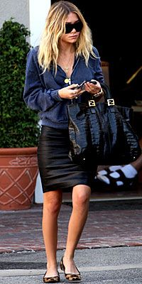 Ashley Olsen in a leather #bodycon skirt, flats, and a cozy-looking hoodie.