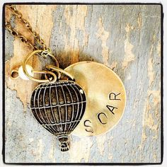 by Etsy  Can you sum up the wonder of a hot air balloon in one word? I think this necklace does it perfectly, reminding us to soa... more »