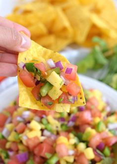 This Fresh and Easy Pineapple Salsa recipe only requires 6 ingredients and 15 minutes to make. It's the perfect appetizer for your next party and would also go great on some super delish fish tacos for a little crunch. So good! // fromcatstocooking.com