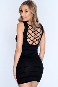 Take your look to a whole new level and add this sexy slinky cut out dress to your collection! Youll sure be center of attention at your next party/event! Just pair it with your favorite AMI heels and flashy accessories for a complete look! it features shimmer fabric, ribbed, scoop neck, sleeveless ,knotted cage back, and tight fitted. 70% Rayon 22% Metallic 8% Acrylic. Made in USA.