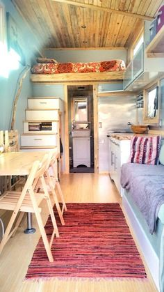 A 159 square feet tiny house on wheels clad in various siding options in Boulder, Colorado.: