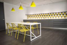 Office furniture. Retro office. Funky. Modern. Work. Splash of colour. Break out area chairs. Minimalist furniture. Storage. Honey bee design. Yellow office.