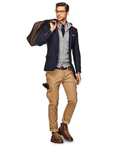 Navy blazer, khaki cargo pants, gray sweater vest, lace up boots, and leather bag.