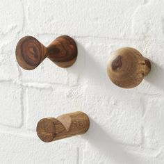 The rich grain of sheesham wood adds natural beauty to this simple utilitarian object, designed exclusively for us.  Hooks affix to a wall for hanging outerwear, towels, cleaning tools and other necessities. Sheesham woodOil finishFor indoor use onlyPlastic anchor includedKeep away from humidity and direct sunlightMade in India.