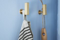 Gorgeous and simple brass cabinet knobs used at hooks, genius!