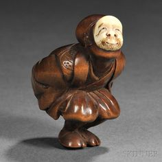 """Wood Netsuke of an Actor, Japan, 19th century, squatting with both of his hands to his back, wearing a mask inlaid in ivory, signed """"Hogyoku"""" to base, ht. 1 1/4 in."""
