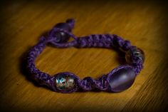 Purple hemp w/glass beads. SOLD  Email me for more info: dkwilson68@hotmail.com