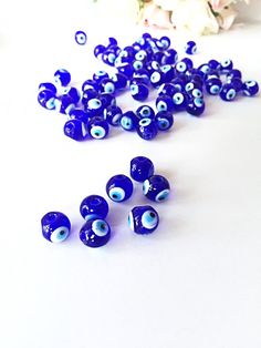 A personal favourite from my Etsy shop https://www.etsy.com/listing/467333856/12mm-blue-glass-evil-eye-beads-10mm-evil