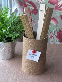 Cork Message Can - Tall Metal Can & a Roll of Thin Cork (dollar store):  Measure the height & circumference of the can.  Cut cork accordingly.  Glue cork onto can using hot glue or Gorilla glue. You may need 2 layers of cork on the can so that the push pins can go in.