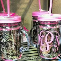 Pink camo drinking jars with a letter inside asking to be a bridesmaid or maid of honor