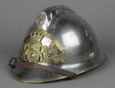 Lot 297, A polished steel French Fireman's helmet, est £60-80