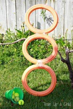 Pool noodle ball toss.  DIY gross motor games.  Invite your friends over and set up a pool noodle ball toss and other pool noodles games!  Simple and inexpensive fun for outdoors.