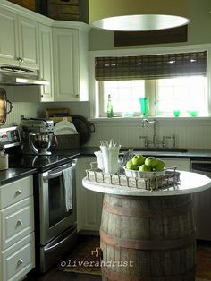 LOVE this fun wine barrel kitchen island! This site has a whole section of eclectic home tours. Perfect inspiration!