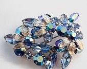 Sparkles for Mom...EcoChic Theme of the week. An Etsy treasury by ViksVintageJewelry that features our Regency brooch! Double click through for other gorgeous sparkly items for the Mother of the Bride to wear!
