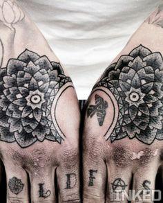 Symmetrical flower hand tattoos by Mike Adams