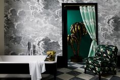 See all our stylish bathroom design ideas including this bathroom with a dramatic Fornasetti wall mural