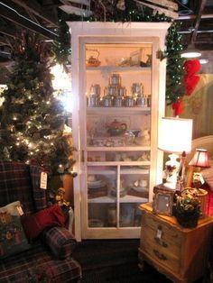 Bookshelf with screen door  via sugarpiefarmhouse.com