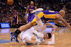 Description of . DENVER, CO - DECEMBER 30: Jusuf Nurkic (23) of the Denver Nuggets and Robert Sacre (50) of the Los Angeles Lakers tangle during the second half of the Lakers' 111-103 win. The Denver Nuggets hosted the Los Angeles Lakers at the Pepsi Center on Monday, December 30, 2014. (Photo by AAron Ontiveroz/The Denver Post)