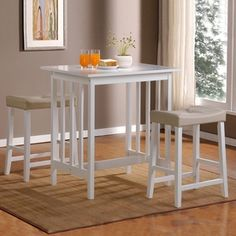Home Sonata White Dining Set with Counter Height Table at Lowe's. Transform a small kitchen into a functional, yet beautiful dining space with this dinette set. The plush, upholstered saddle back stools of this Kitchen Dining Sets, Counter Height Dining Table, Dining Room Sets, Dining Room Furniture, Kitchen Corner, Kitchen Kit, Kitchen Tables, Kitchen Living, Kitchen Ideas
