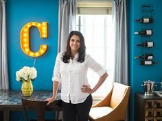 Cecily Strong's Apartment Makeover featuring Lubna Chowdry Table + Cabinet + Curved Leather Chair from west elm
