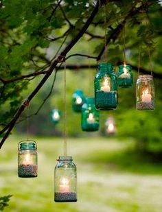 Outdoor lighting - hanging mason jars with candles and sand. I love the idea of using mason jars as decoration. Mason Jar Lighting, Mason Jar Lamp, Candle Jars, Candle Sticks, Jam Jar Candles, Kilner Jars, Mason Jar Candle Holders, Hurricane Candle, Mason Jar Crafts