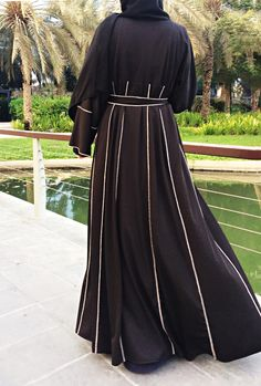 Trendy abaya with panels and contrast hemming stitch decor in beige color. Relaxed fit and flowing silhouette. Made of premium blac Muslim Dress, Hijab Dress, Hijab Outfit, Abaya Fashion, Muslim Fashion, Fashion Outfits, Modest Outfits, Simple Outfits, Black Abaya