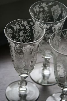 Fostoria (?) Etched glass   LOVE THESE  10ish water goblets for the table or  6 - 10 champagne bowls to use as dessert dishes