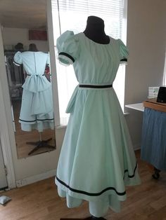 Young girl's turn of the century dance dress. Costumes are designed and cut to fit your costume needs. Miss Em 713-398-7571