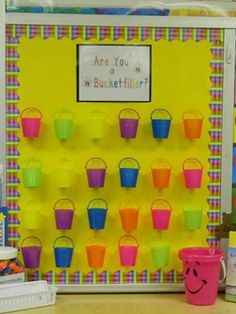 bucket fillers; this site talks about the source of bucket filling as well as a compliment form for students to fill out and put in others' buckets. I might have an envelope for each student plus the bucket. Pom poms go in the bucket and comments go in the envelope