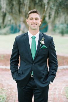 Modern groom in charcoal gray suit + green tie with matching pocket square {Aaron and Jillian Photography}