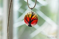 Tree pendant / tree necklace red yellow and white fused glass.  Eerin Vink is an illustrator and artist. She also makes jewelry. You can find this artist on Etsy: https://www.etsy.com/shop/EerinVinkArts.